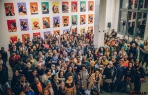 Image of PAALF members and other community at an art opening for the Albina Queens photo project